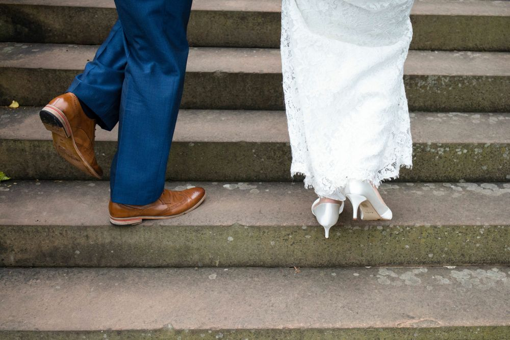 Bride and groom feet on steps Shrewsbury Castle