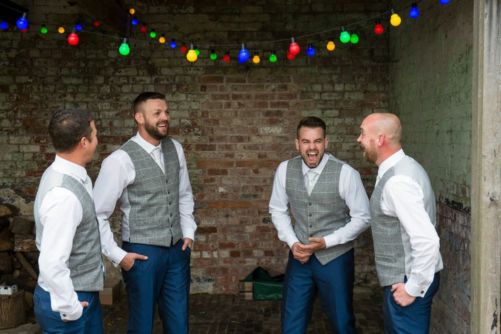 Relaxed groomsmen with carnival lights