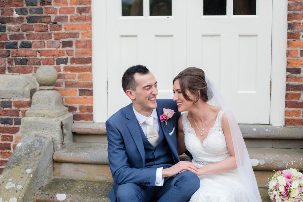 Relaxed bride and groom at Albrighton Hall Hotel