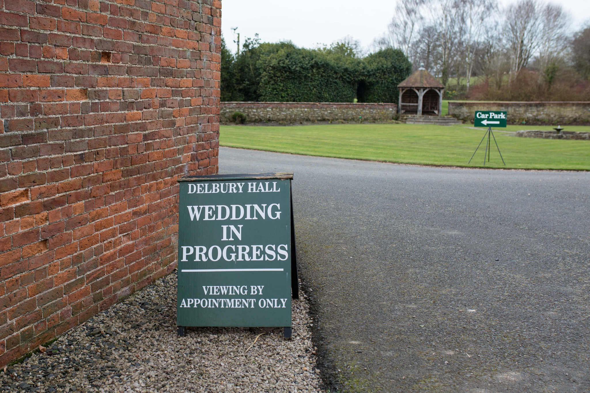 Delbury Hall Wedding in progress A board sign Spring wedding