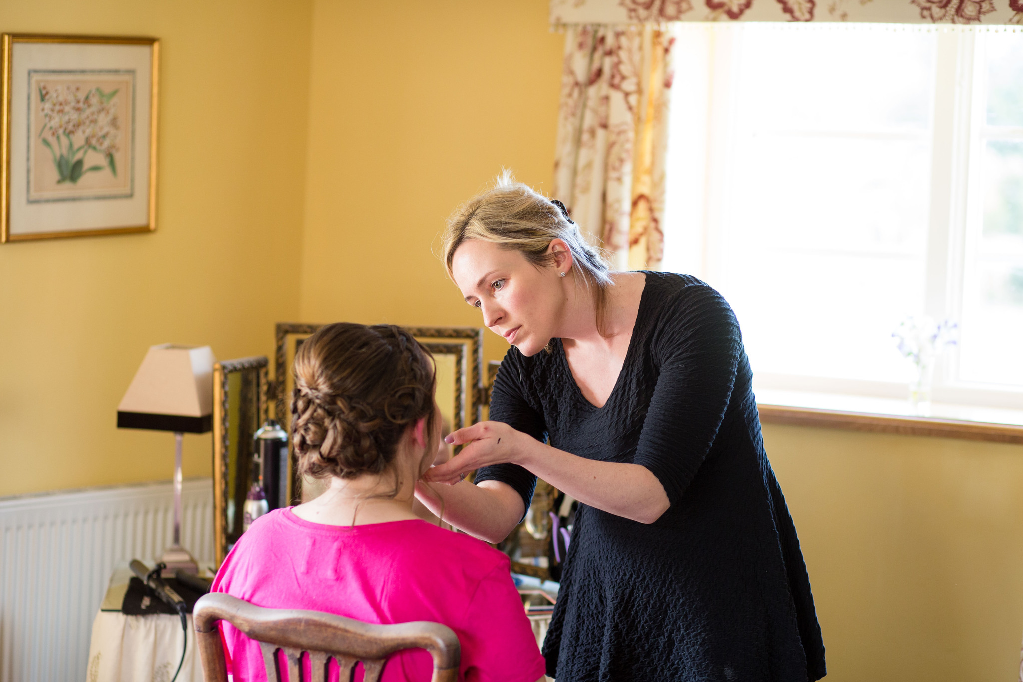 Having make up done bride in bright pink t shirt