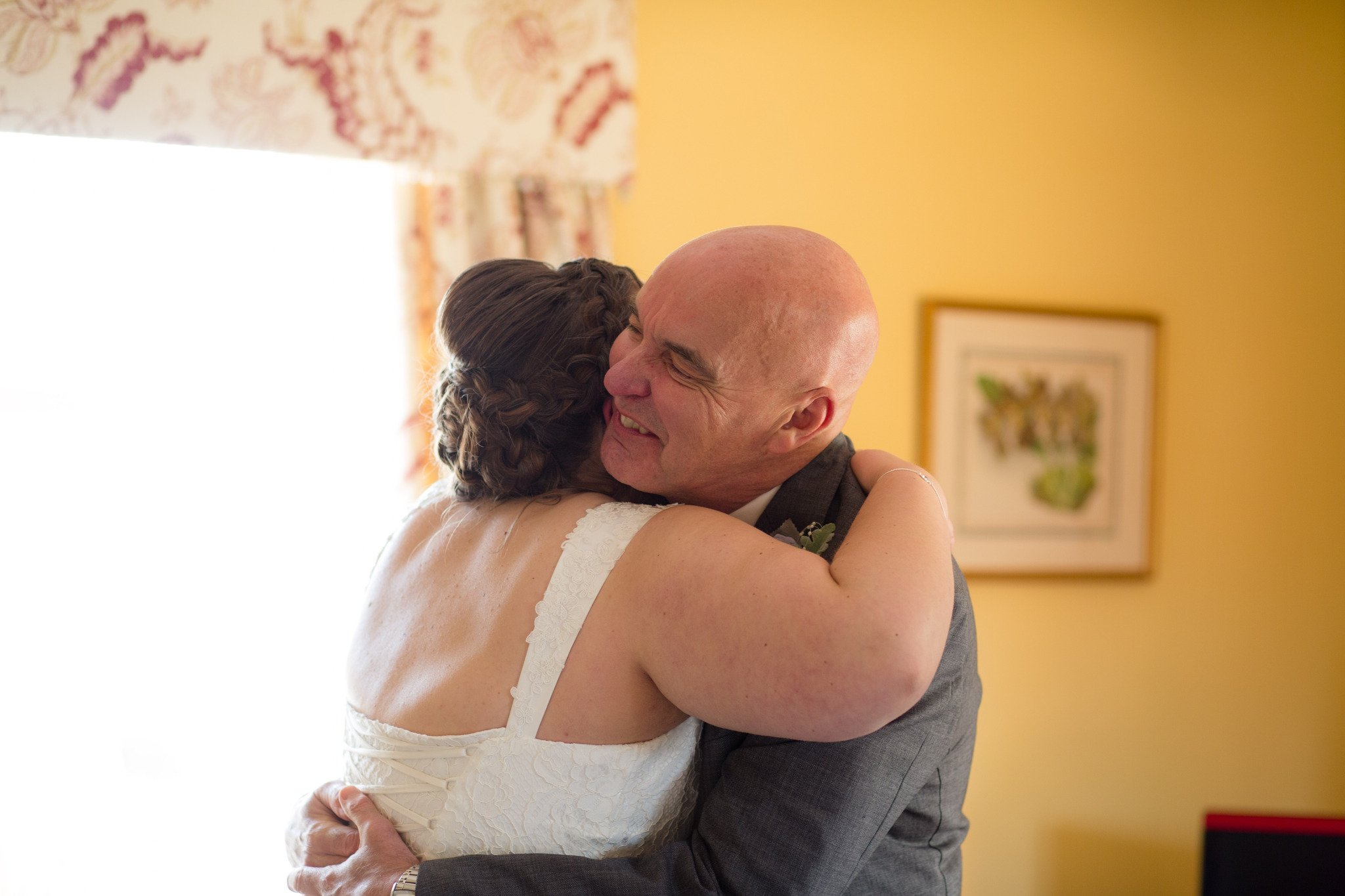 Bride and dad hugs for first time