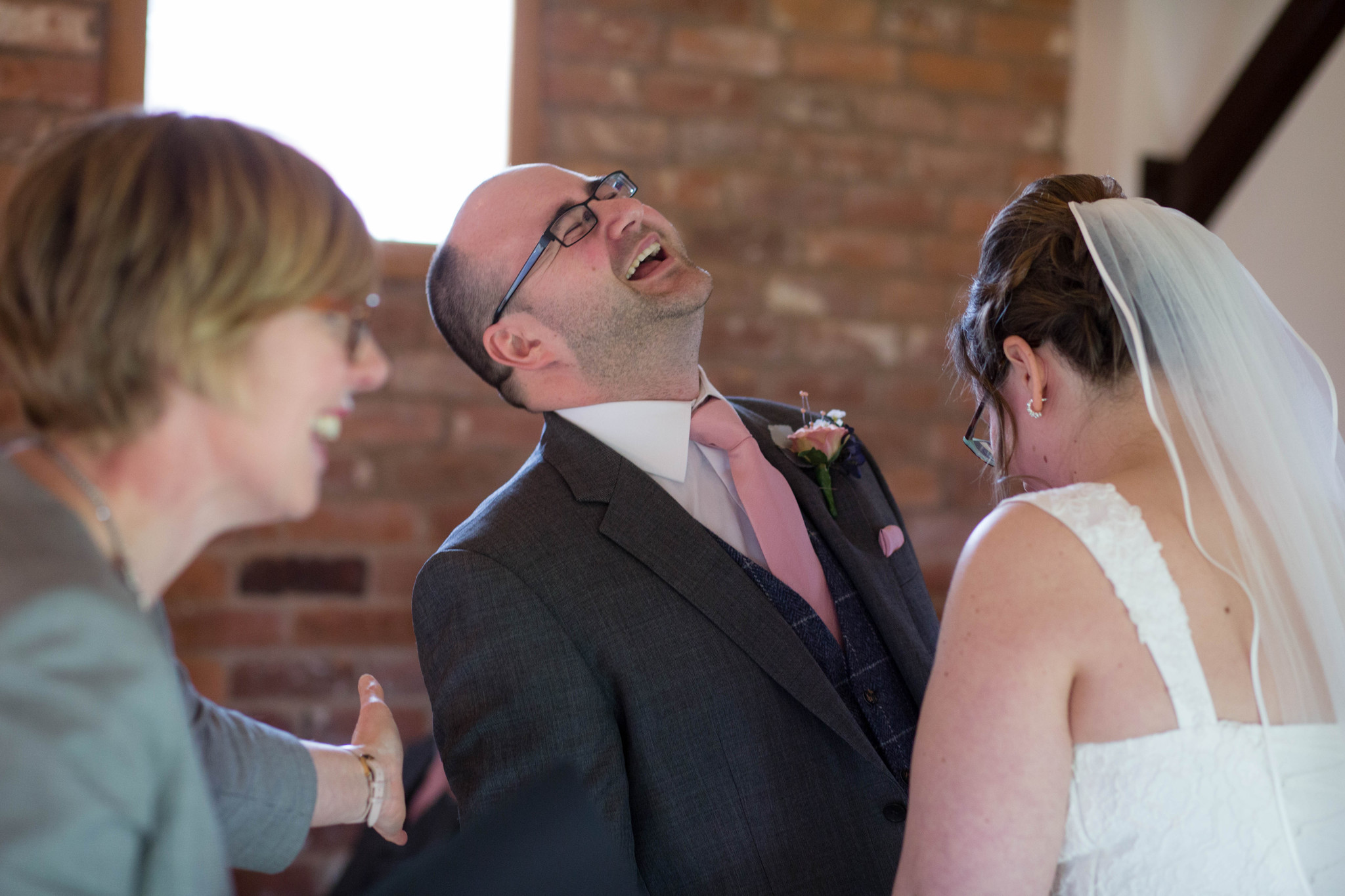 Groom laughing indoor ceremony Delbury Hall