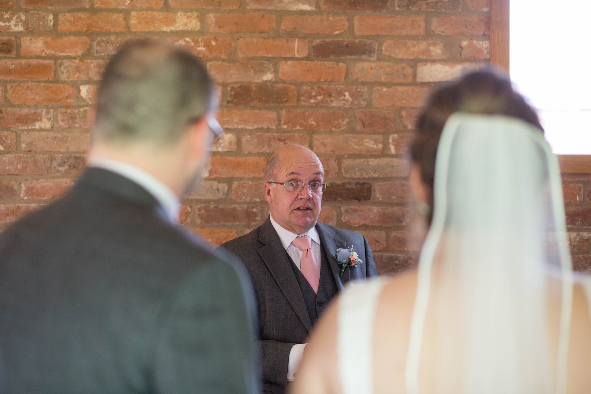 Step Father of the groom reading during indoor ceremony Delbury Hall