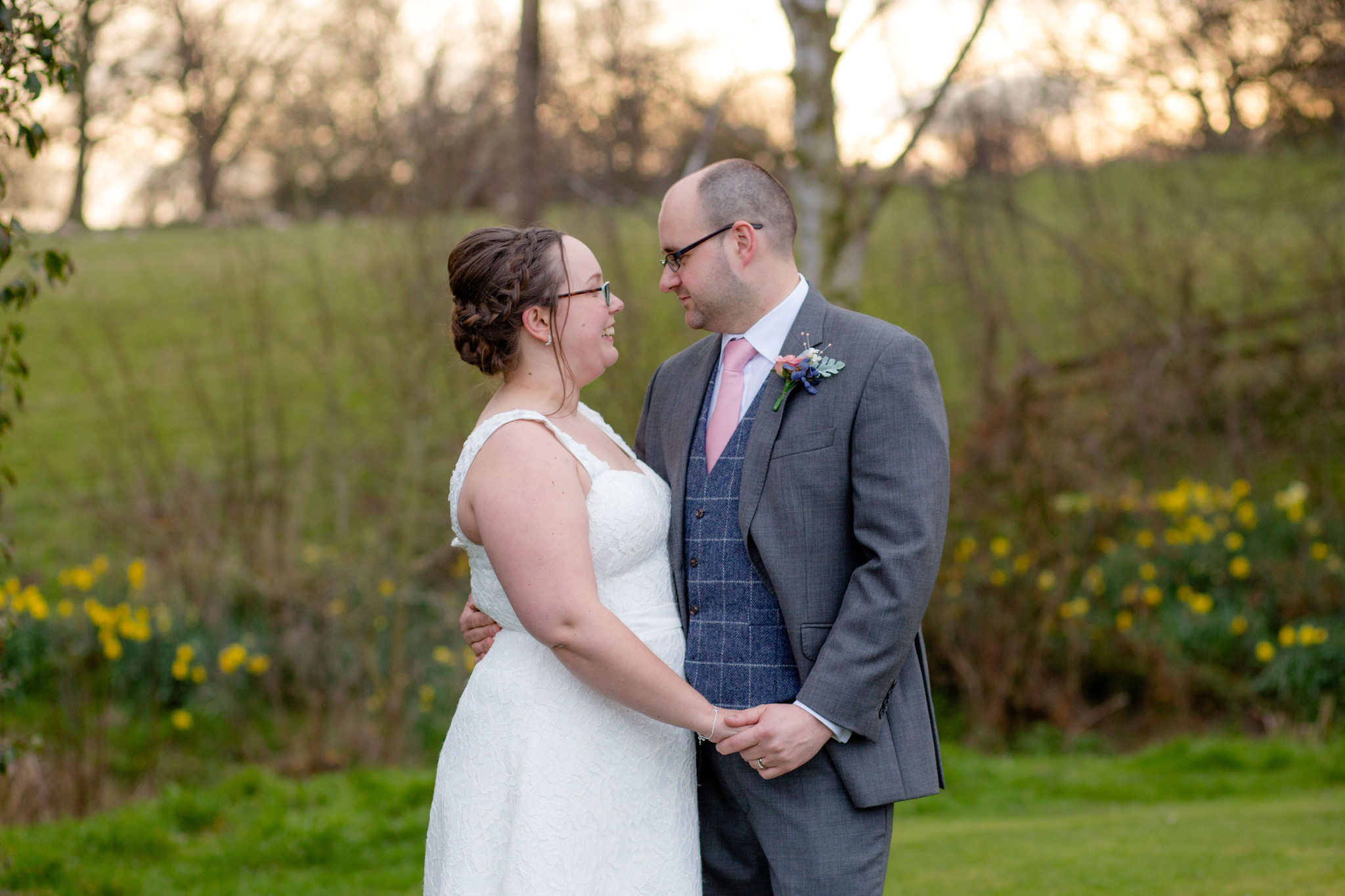 Golden hour couples portraits delbury Hall Spring wedding daffodils