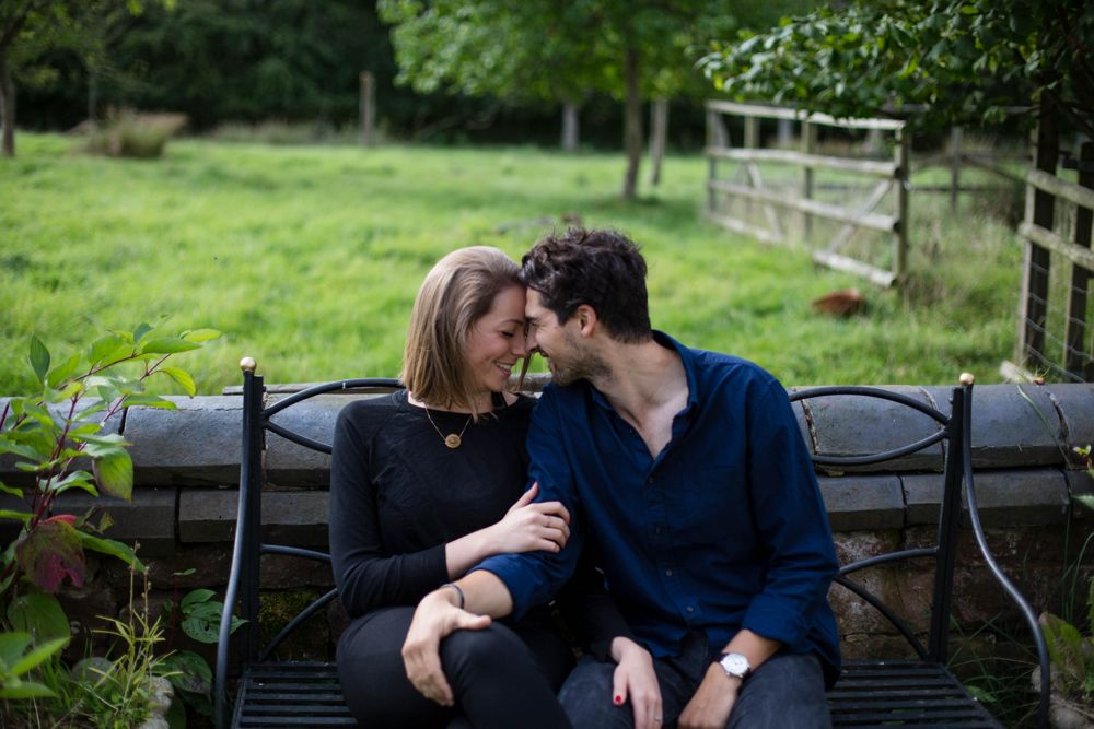Couple photo shoot on bench outdoors summer time countryside