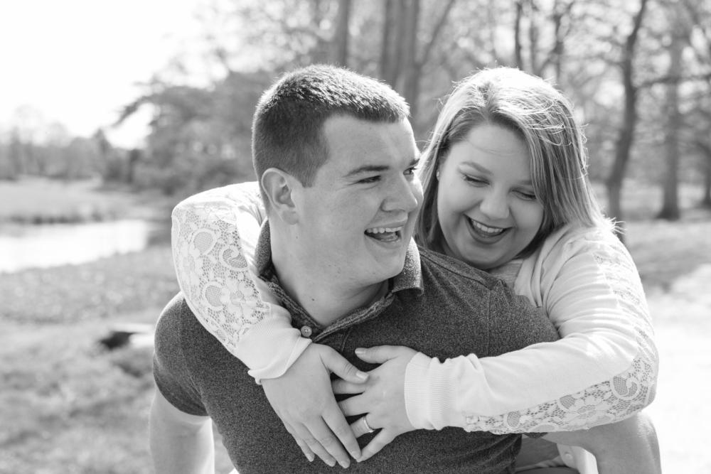 Attingham park couple shoot black and white photo piggy back laughing