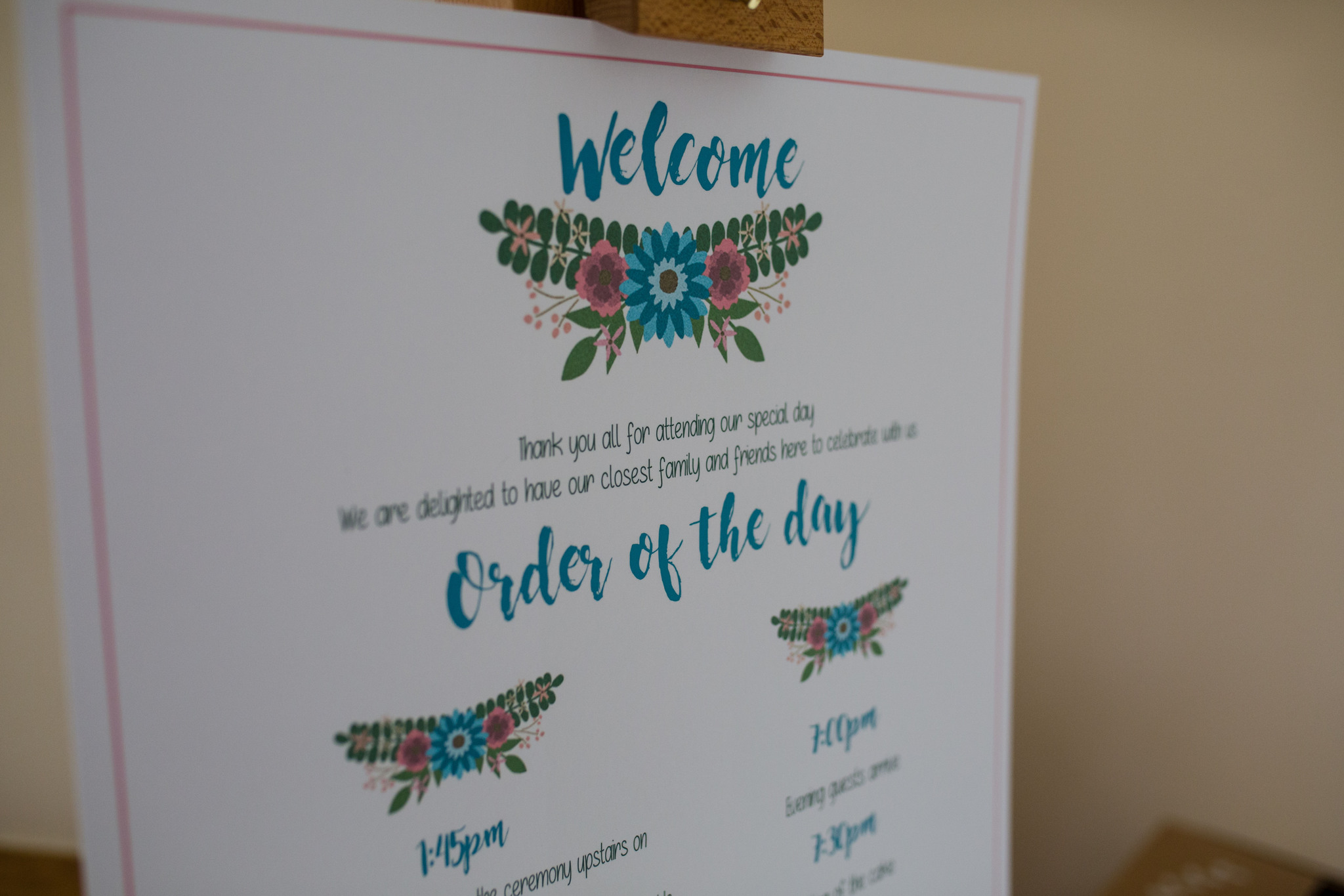 Order of the day sign with hand painted cake images Delbury Hall