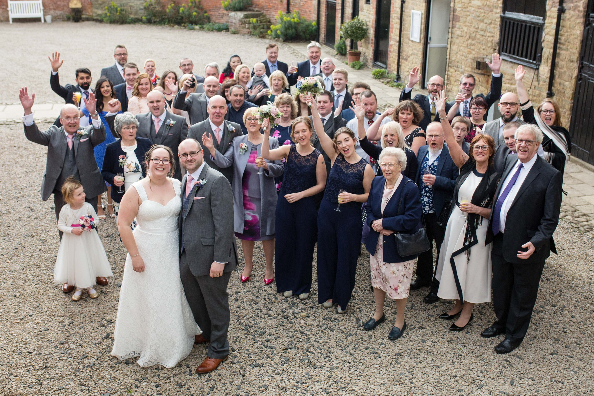 Large group photo exterior Delbury Hall Spring wedding