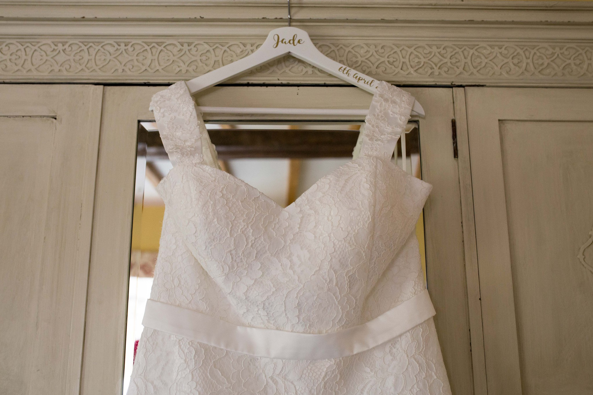 Delbury Hall wedding dress hanging on wardrobe door
