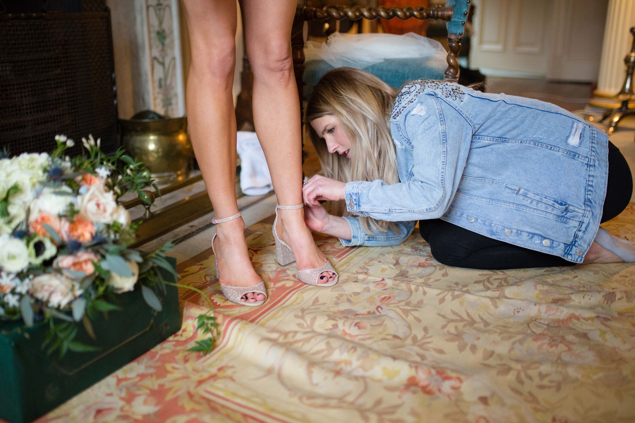 Bride's feet getting into shoes Walcot Hall