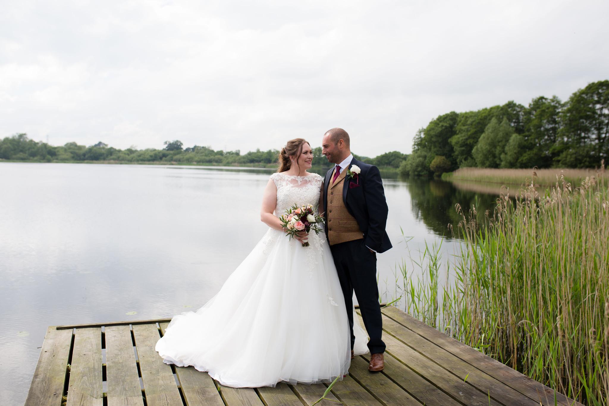 Shropshire wedding photography Shrewsbury waterside wedding on a jetty by Nicola Gough