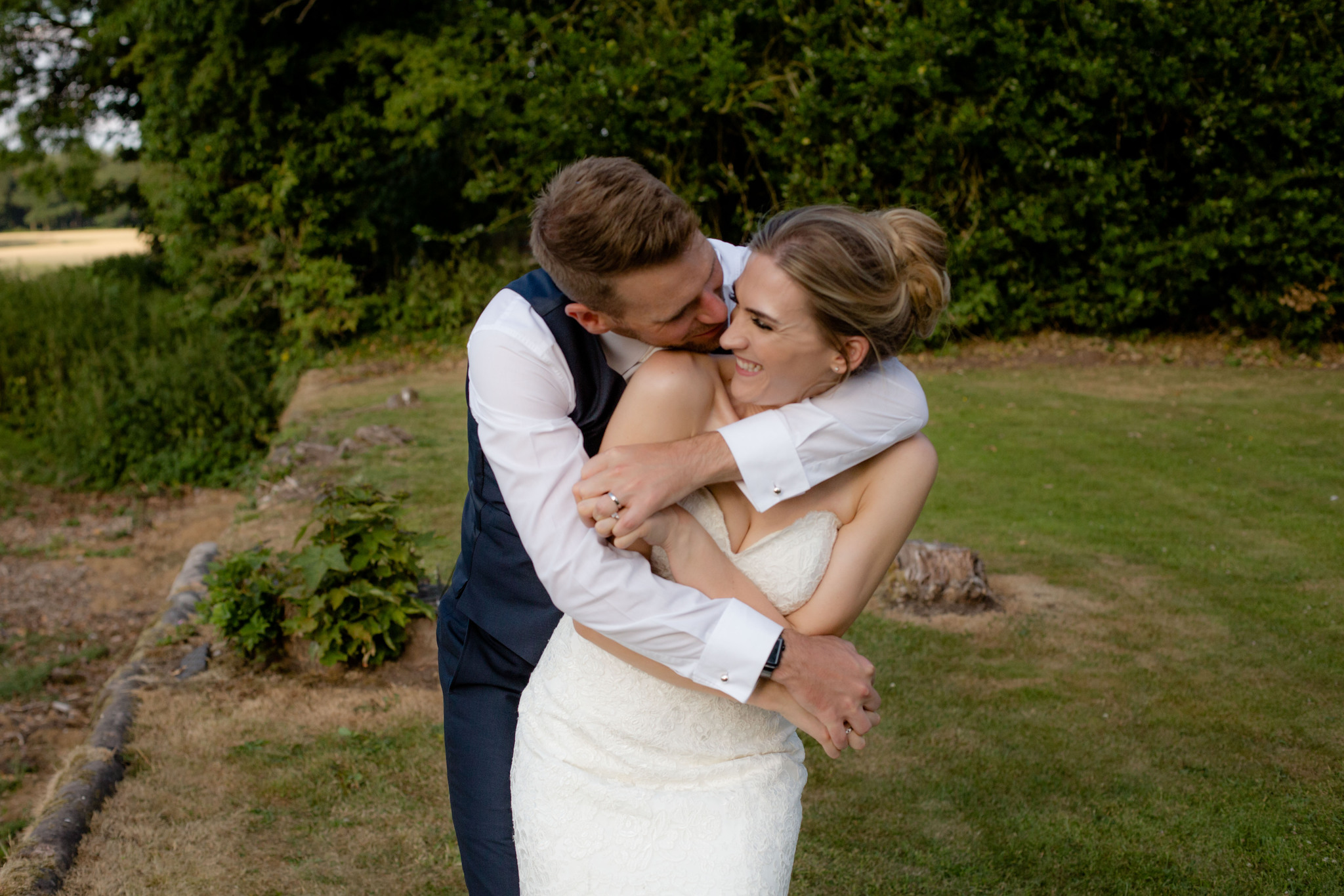 Shropshire wedding photographer golden hour romantic portraits of a couple laughing at Somerford Hall