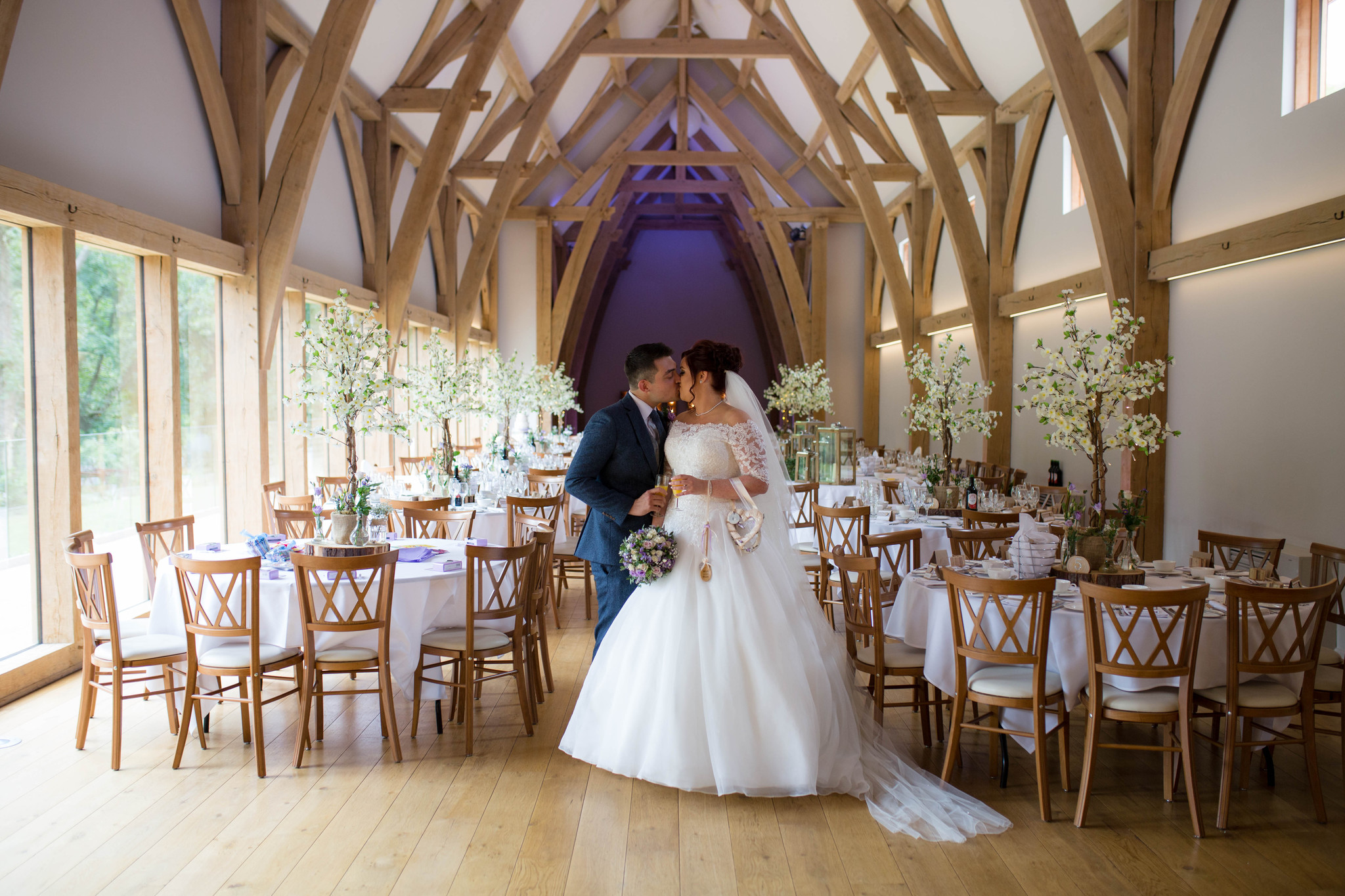 mill barns wedding venue wedding breakfast set up with blossom trees