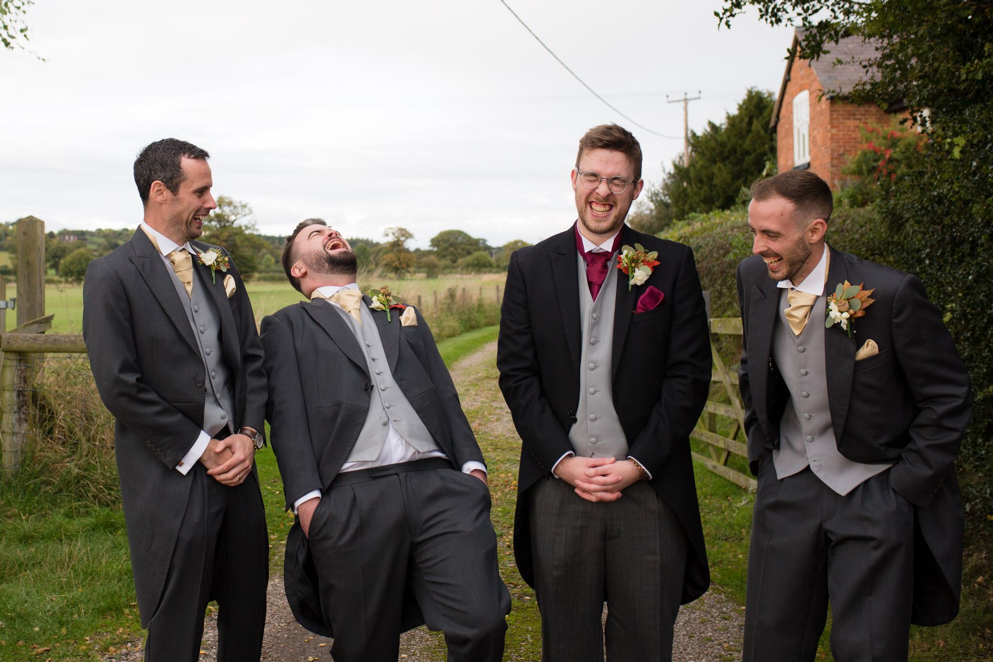 Wedding photographer Shropshire fun group photos at weddings of groomsmen in a field